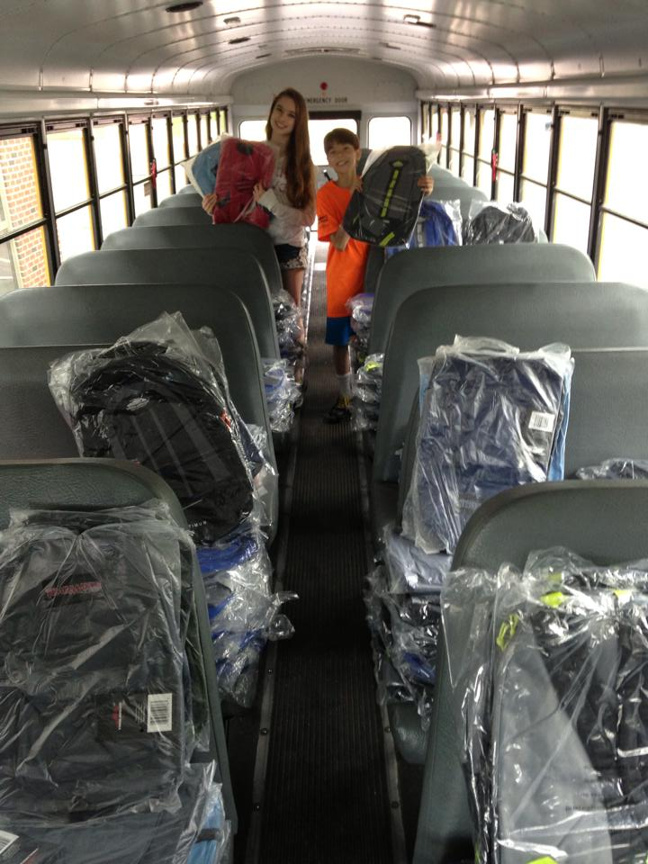 stuff the bus with backpacks